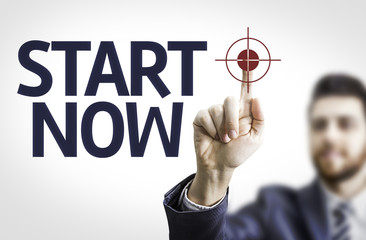 Business man pointing the text: Start Now