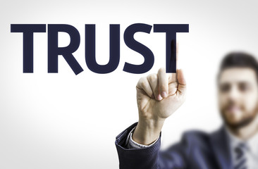 Business man pointing the text: Trust
