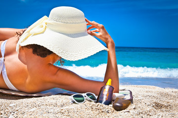 Woman in sunhat  enjoying looking view of beach
