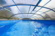 Outdoor swimming pool with a shelter