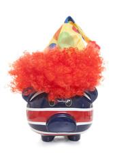 piggy bank wearing a clowns hat