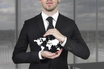 businessman protecting world map