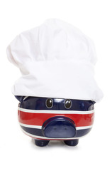 piggy bank wearing a chefs hat