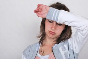 Teen girl looking discouraged