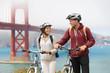 Biking Golden Gate Bridge - couple sightseeing