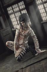 Insane girl in bloody straitjacket