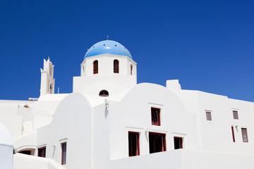 White buildings with blue domes. Oia on Santorini island, Greece
