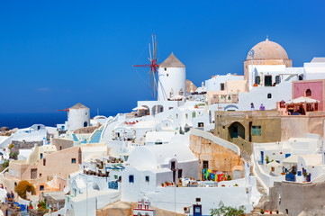 Oia town on Santorini island, Greece.  Famous windmills