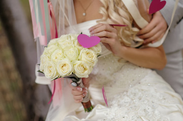 wedding bouquet in hands of the bride of roses