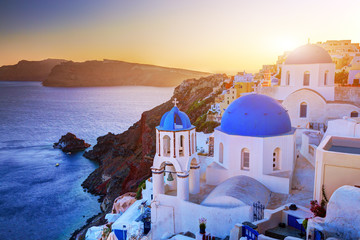 Oia town on Santorini island, Greece at sunset. Aegean sea.