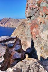Cliff and volcanic rocks of Santorini island, Greece.