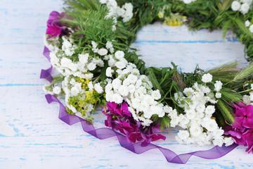 Wildflower wreath on grey wooden background