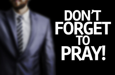 Don't Forget to Pray written on a board