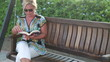 Woman relaxing in the park and reading a book