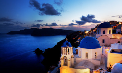 Oia town on Santorini island, Greece at night. Aegean sea.