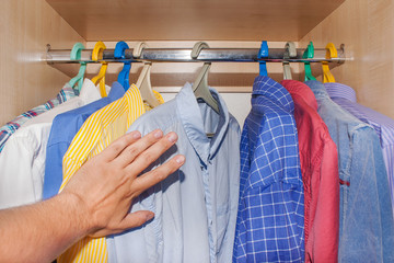 selection of shirts in the closet.
