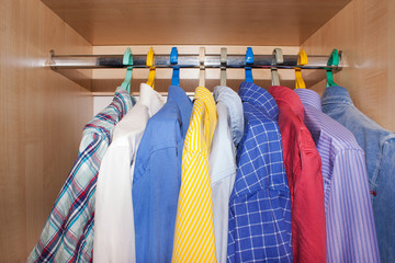 men's shirts in the closet.