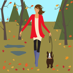 girl and dog walking in autumn park