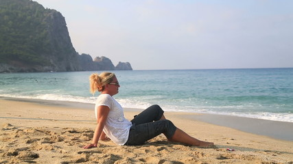 Attractive  woman relaxing on the beach