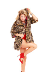 Sexy woman in a fur coat