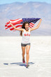 Athlete woman with american flag running
