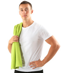 Handsome young sportsman holding towel isolated on white