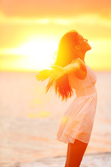 Freedom woman enjoying feeling happy free at beach
