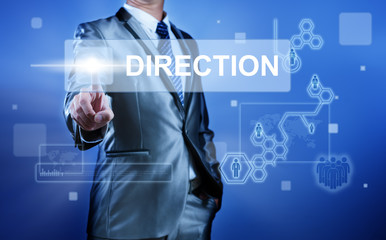 Business man with digital screen press on button direction