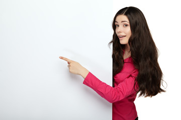 Young smile woman pointing at a blank board