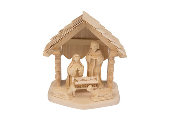 Wooden hand made Christmas crib on a white background