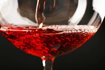 Glass of red wine on dark background closeup