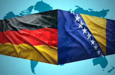 Waving Bosnian and German flags