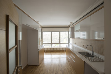 New empty kitchen for your refrigerator, oven