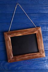 Vintage frame on wooden background