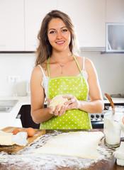 beautiful young woman preparing cakes