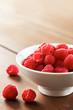 Fresh raspberries in white bowl