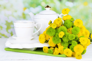 Bouquet of flowers, teapot and cup