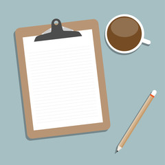 Classic brown clipboard with blank white paper.  with coffee and
