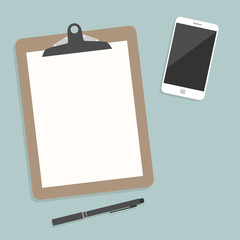 Classic brown clipboard with blank white paper.  with smartphone