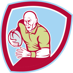 Rugby Player Running Charging Shield Cartoon
