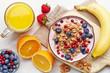 Leinwandbild Motiv Healthy breakfast. Yogurt with granola and berries