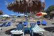 Sunbeds and umbrella on beach