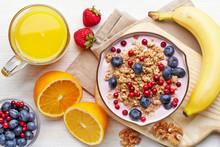 """Постер, картина, фотообои """"Healthy breakfast. Yogurt with granola and berries"""""""