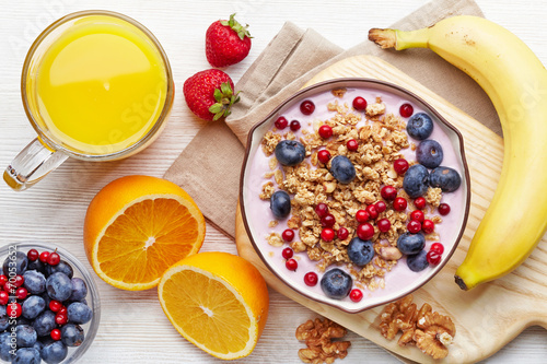 Foto op Canvas Dessert Healthy breakfast. Yogurt with granola and berries