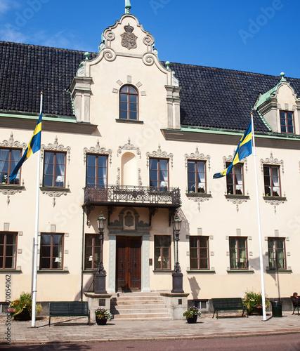 canvas print picture Haus mit Fahnen in Schweden