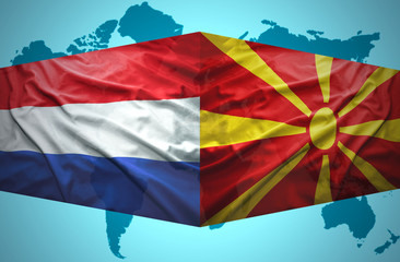 Waving Macedonian and Dutch flags