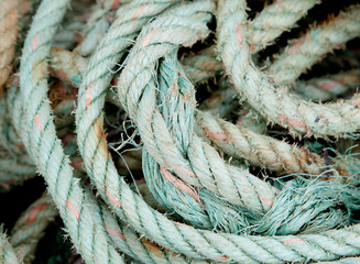 Photo of an old worn rope rolled