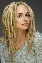 Portrait of a beautiful girl with dreadlocks
