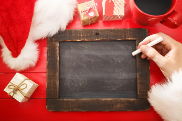 Blank chalkboard with Christmas wishlist ingredients