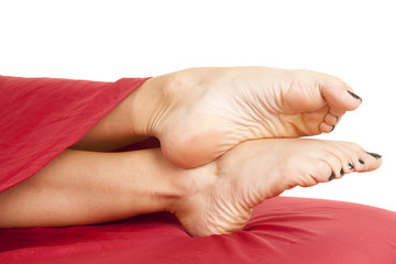 woman feet toes pointed red sheet